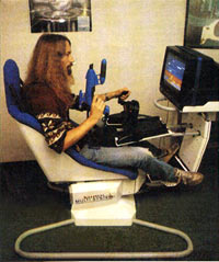 Jeff Minter astride the mighty Power Chair playing AMC '89